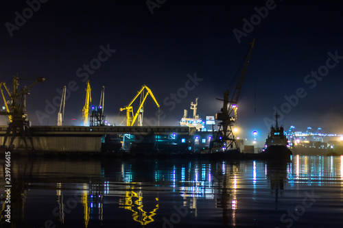 Poster London The night. Sea port. Cargo ship stands in the dock
