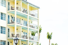 Pastel Yellow Orange Green Blue Painted Colorful Architecture Exterior Of Condo Apartment Building Hotel Resort In Florida Beach Home, Pattern, Many Balconies