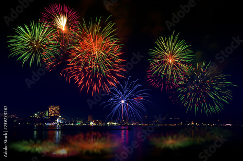 Photo  Colorful fireworks celebration and the city night light with twilight sky background