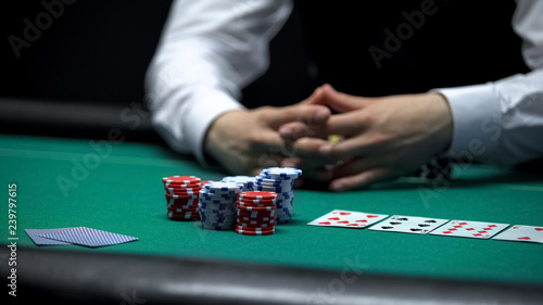 Tela Casino client poker player making bet with all chips, chance to win at gambling