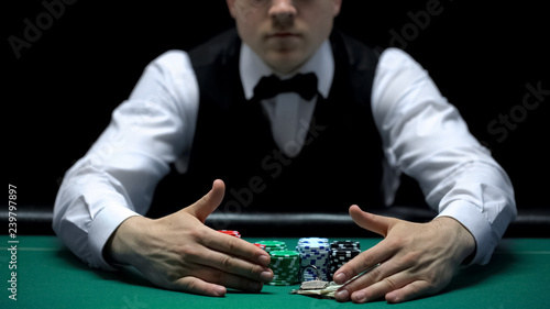 Fotografia, Obraz  Croupier taking all win away from casino player, misfortune and bankruptcy