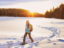 Winter Sport Woman Hiking In S...