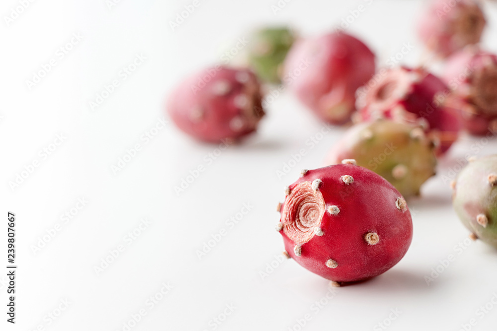 Fototapeta Prickly pear fruit on a white background, creative food concept, prickly pear cactus, Opuntia ficus-indica