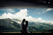 Silhouette of a couple kissing with the mountains of Switzerland through the window behind them