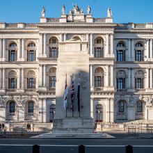 The London Cenotaph War Memorial Situated On Whitehall With The Foreign And Commonwealth Office Government Building In The Background.