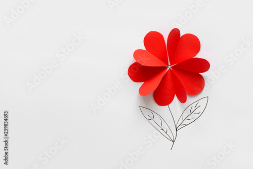 Valentines day card. Red paper heart shape flower on white paper background. Paper cut style and minimalist concept