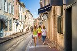 Fototapeta Uliczki - Tourists walking on the streets of Saint-Tropez old town