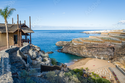 Beautiful small bay with sand beach and wooden house on top of hiking path to it Fototapeta