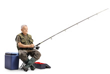 Fisherman Sitting On A Chair With A Fishing Rod