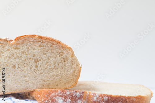 Fotografie, Obraz  Fresh home made bread on white table background with napkin