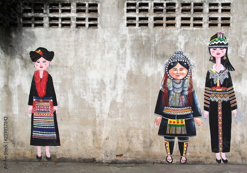Canvas Prints Athens Painting of hilltribe people on concrete wall.