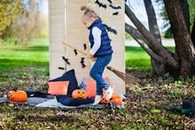 Girl On Halloween Playing With...