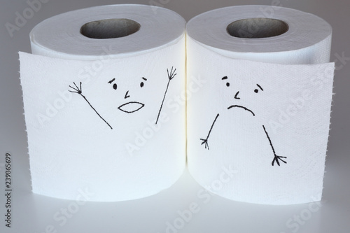 Fotografía Two white toilet paper rolls sketched with a shouting and a melancholic face, cl