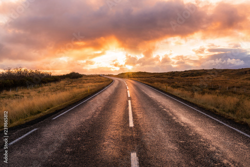 Montage in der Fensternische Cappuccino Majestic Orange Sunset over Country Road in Iceland in Autumn