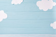 canvas print picture - Cute children or baby background, white clouds on the blue wooden background