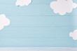 Leinwandbild Motiv Cute children or baby background, white clouds on the blue wooden background
