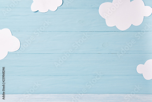 Obraz Cute children or baby background, white clouds on the blue wooden background - fototapety do salonu