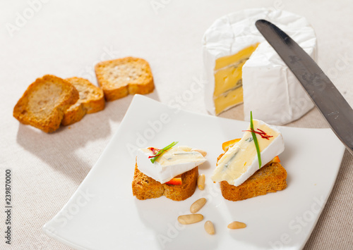 Canape with orange and blue cheese