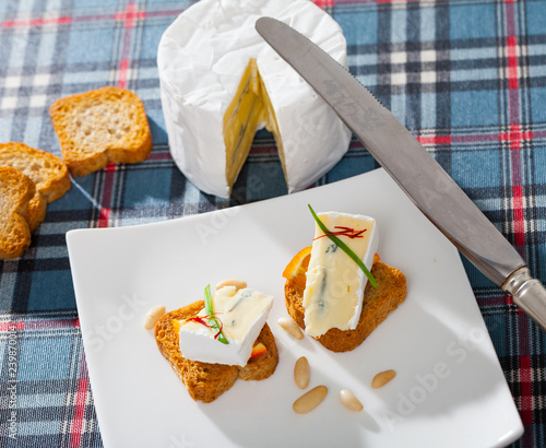 Toasted bread with soft blue cheese and orange