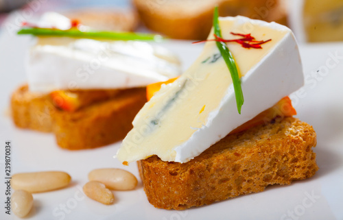 Delicious settee-bed with brie cheese