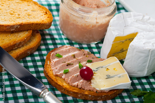 Pate on toasted bread with soft blue cheese
