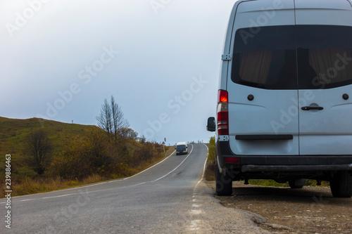 Fotografie, Obraz  Minibus stands on the road