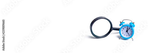 Magnifying Glass And A Clock The Concept Of Finding Free Time For A Hobby Family Leisure And Work Temporary Replacement Search Urgent Search Investigation Planning And Self Improvement Banner Buy This Stock