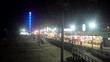 Ocean amusement pier and boardwalk on a foggy night at the Jersey Shore.