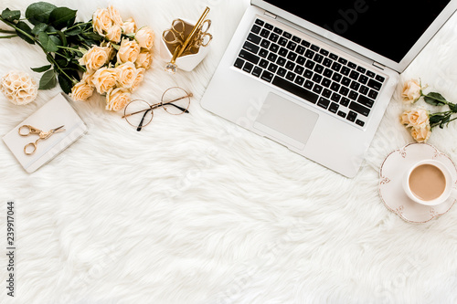 Fotografie, Tablou Female workspace with laptop, roses flowers bouquet, golden accessories, diary, computer, glasses on white background