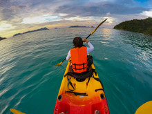 Tourist Sailing Sea Kayak In Beautiful Blue Water Of Tropical Island