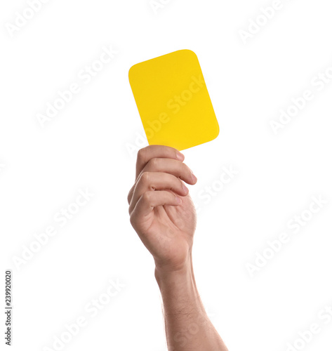 Man holding yellow card on white background, closeup of hand