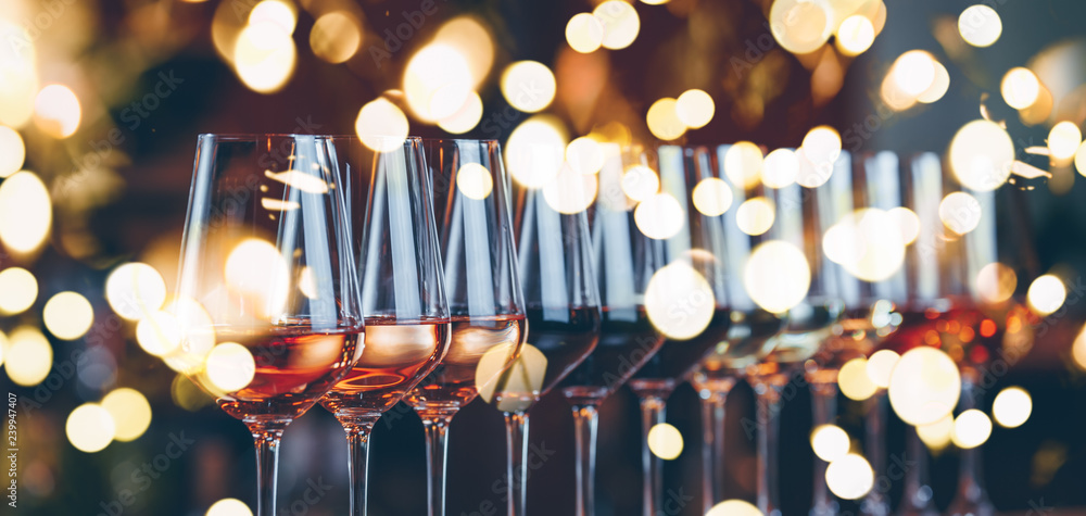 Fototapety, obrazy: Wine glasses in a row. Buffet table celebration of wine tasting. Nightlife, celebration and entertainment concept