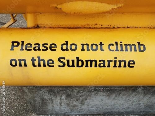 Photo  please do not climb on the submarine sign on yellow submarine