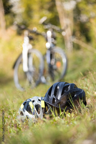 Fotografie, Obraz  Bike helmets in the grass, bike tour