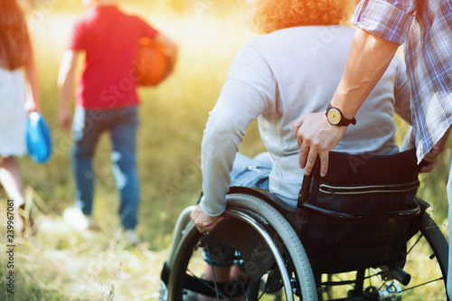 Tableau sur Toile Close up look on woman's back in a wheelchair.