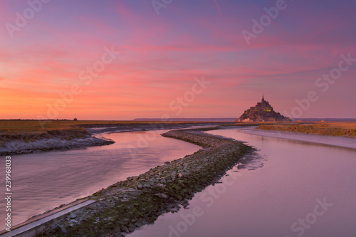 Le Mont Saint Michel in Normandy, France at sunset