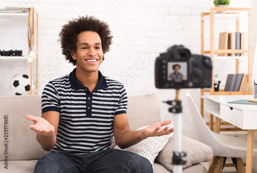 Young male blogger recording video at home Canvas Print