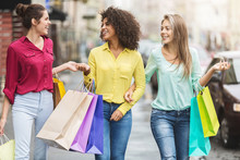 Women Walking With Shopping Bags In The City