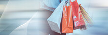Woman Walking And Holding Shopping Bags. Panoramic Banner