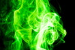 Leinwandbild Motiv Green smoke on black background