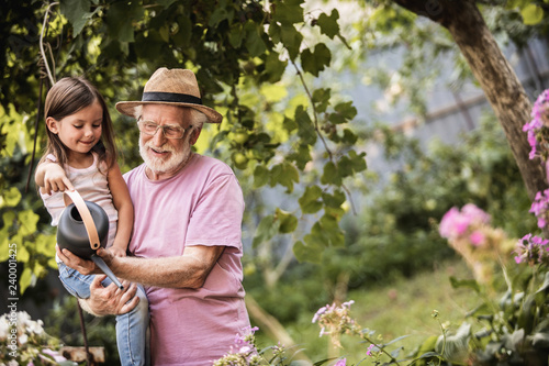 Stampa su Tela  Grandparent with his grandchild spending time together in countryside