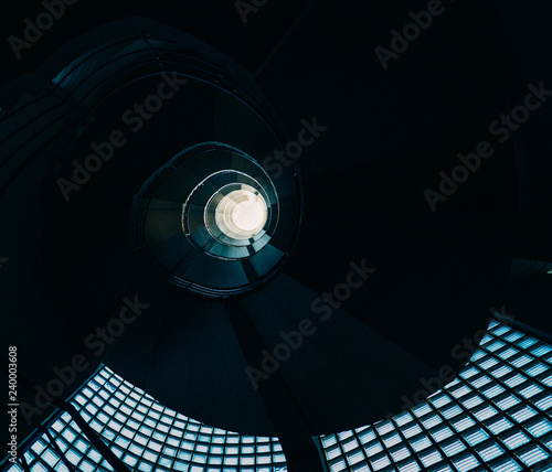 Fototapeta Beautiful and hypnotic spiral convoluted staircase, wide angle