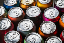 Aluminum Cans Of Soda Background. The View From The Top