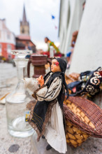 Traditional Puppet In Bazar With The Lutheran Cathedral Of Saint Mary From Sibiu In Fundal