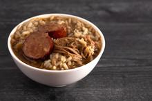 Bowl Of Sausage And Chicken Gu...