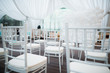 White chairs, beautiful decoration for wedding day.