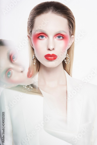 Keuken foto achterwand womenART Sexy lady with bright makeup in white jacket