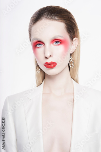 Tuinposter womenART Sexy lady with bright makeup in white jacket