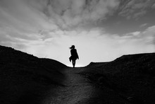 Silhouette Of Woman On Top Of Mountain