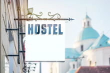 HOSTEL Signboard In Black Letters On A White Background In The City, Copy Space, Mock Up